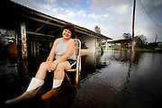 Cindy Lacy poses for a portrait in front of her house that was flooded by the rains and surge of Hurricane Gustav, Sept. 02, 2008. (U.S. Air Force photo by Staff Sgt. Shawn Weismiller)