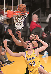 January 24, 2019 - Los Angeles, California, U.S - Karl-Anthony Towns #32 of the Minneapolis Timberwolves defends against Ivica Zubac #40 of the Los Angeles Lakers during their NBA game on Thursday January 24, 2019 at the Staples Center in Los Angeles, California. Lakers lose to Timberwolves, 105-120. (Credit Image: © Prensa Internacional via ZUMA Wire)