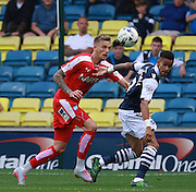 Chesterfield player Daniel Jones and Millwall player Paris Cowan-Hall compete for a high ball during the Sky Bet League 1 match between Millwall and Chesterfield at The Den, London, England on 29 August 2015. Photo by Bennett Dean.