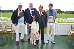 Left to right, RASHID AL HABTOOR, ROBERT GIBBONS, MARYAM AL HABTOOR, KHALAF AL HABTOOR and MOHAMMED AL HABTOOR at Al Habtoor Royal Windsor Cup Final 2012 at Guards Polo Club, Berkshire on 24th June 2012.