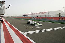 BAHRAIN, BAHRAIN - Sunday, April 26, 2009: Jenson Button (GBR Brawn-Mercedes) takes the chequered flag as he wins the Bahrain Grand Prix at the Bahrain International Circuit. (Pic by Michael Kunkel/Hoch Zwei/Propaganda)