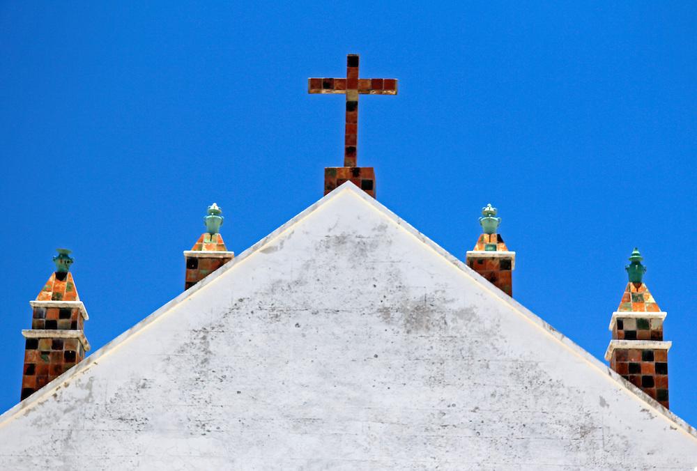 South America, Bolivia, Copacabana. Basilica of Our Lady of Copacabana cross on gate.