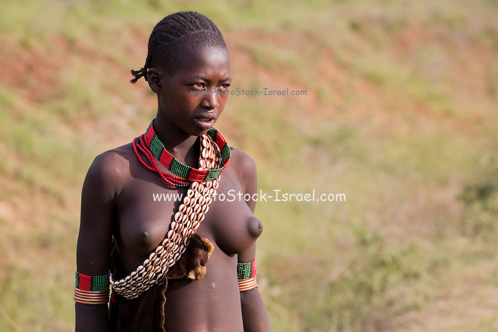 Portrait of a Young topless teen member of the Bena Tribe, Omo Valley, Ethiopia