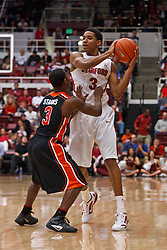 Feb 16, 2012; Stanford CA, USA; Stanford Cardinal guard/forward Anthony Brown (3) is defended by Oregon State Beavers guard Ahmad Starks (3) during the first half at Maples Pavilion.  Mandatory Credit: Jason O. Watson-US PRESSWIRE