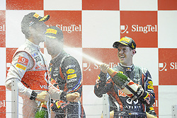 25.09.2011, Marina-Bay-Street-Circuit, Singapur, SIN, F1, Grosser Preis von Singapur, Singapur, im Bild Podium -  Jenson Button (GBR),  McLaren F1 Team  - Mark Webber (AUS), Red Bull Racing - Sebastian Vettel (GER), Red Bull Racing // during the Formula One Championships 2011 Large price of Singapore held at the Marina-Bay-Street-Circuit Singapur, 2011-09-24  EXPA Pictures © 2011, PhotoCredit: EXPA/ nph/  Dieter Mathis       ****** out of GER / CRO  / BEL ******