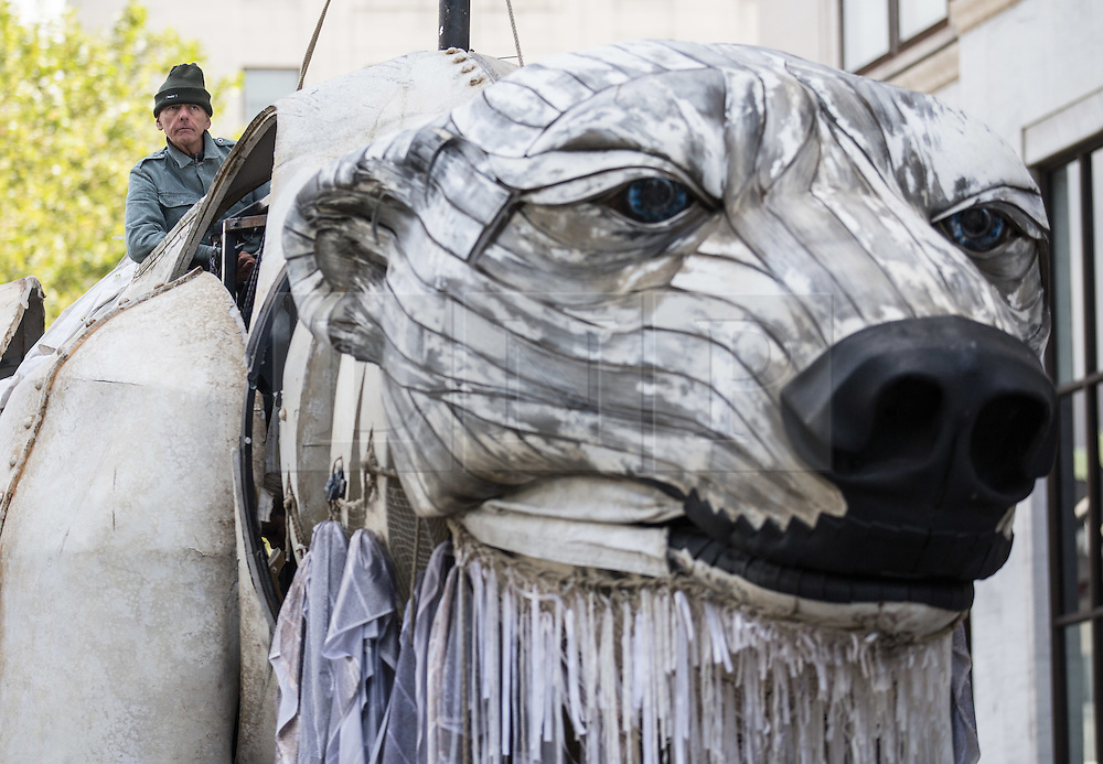 © Licensed to London News Pictures. 02/09/2015. London, UK. 'Aurora' a large human operated Polar Bear built by Greenpeace activists pictured outside the Shell Building on the Southbank today. The activists intend to picket outside the oil company's headquarters until they abandon plans to drill for oil in the Arctic. Photo credit : James Gourley/LNP