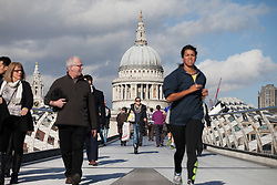 London enjoys sunny weather this afternoon. People walking through millennium Bridge enjoying the weather. London, United Kingdom. Monday, 24th February 2014. Picture by Daniel Leal-Olivas / i-Images