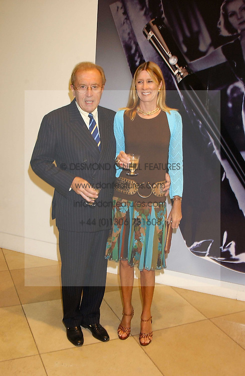 SIR DAVID & LADY CARINA FROST at a private view of 'The World's Most Photographed' exhibition hosted by Vanity Fair and Mont Blanc to celebrate Greta Gabo's 100th Birthday at the National Portrait Gallery, St.Martin's Place, London on 19th September 2005.<br /><br />NON EXCLUSIVE - WORLD RIGHTS
