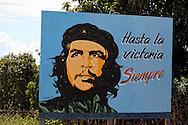 Che on the south coast road from Santiago de Cuba to Pilon.
