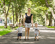Photo of mom walking with her two boys on Commonwealth Ave Mall in Boston, MA.