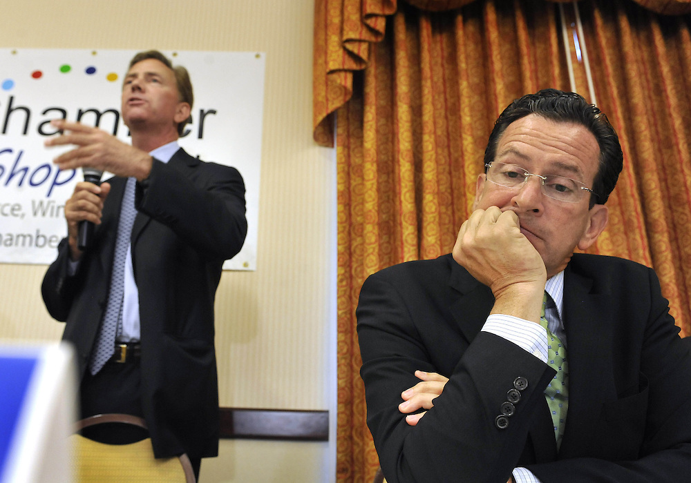 Democratic candidate for governor Dan Malloy, right, listens as opponent Ned Lamont, left, speaks in a forum hosted by the Windham Chamber of Commerce, in Storrs, Conn., Thursday, July 29, 2010.  (AP Photo/Jessica Hill)