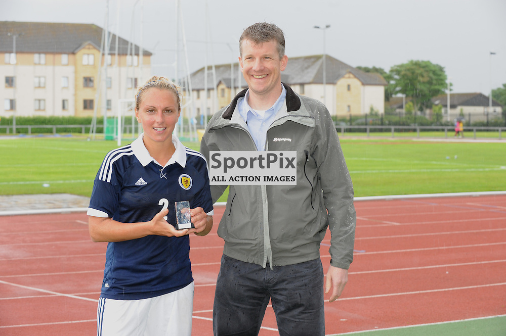 Rhonda Jones collects her player of the match award from dirctor fo Simmons International after the Cameroon vs Scotland in pre Olympic warm up match. 15th July 2012.