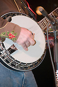 Close up of hands playing a banjo