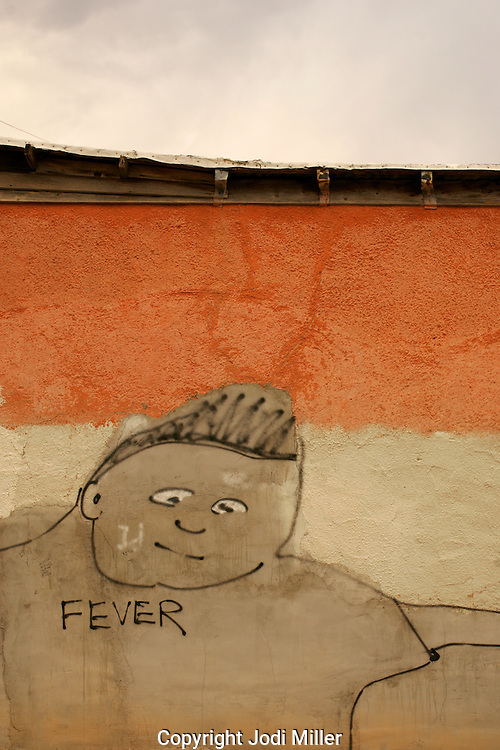 Graffiti on a stucco wall in downtown Tucson.