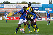 Jabo Ibehre holds up Ayo Obileye during the Sky Bet League 2 match between Carlisle United and Dagenham and Redbridge at Brunton Park, Carlisle, England on 12 September 2015. Photo by Craig McAllister.