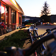 Bikes line the exterior of Moe's BBQ in Eagle, Colorado after a late evening ride before Dinner.