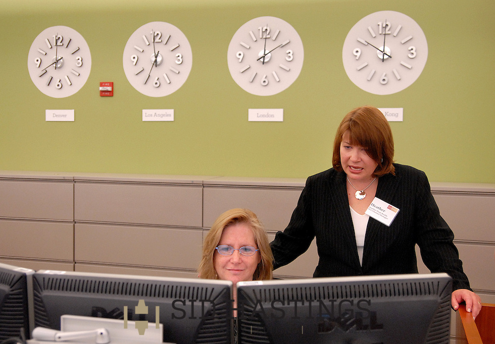 20 MAY 2010 -- ST. LOUIS -- Heather Hunt-Ruddy (right), who works for Wells Fargo Advisors in Detroit, talks with St. Louis trader Beverly Gordon while visiting the trading floor at Wells Fargo Advisors in St. Louis Thursday, May 20, 2010. The company opened a new, high-tech trading floor in March. Photo © copyright 2010 Sid Hastings.