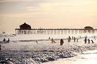 21 June 2008:  Record summer heat brings people to the Pacific Ocean to play in the surf at tower 9 in Huntington Beach, CA.