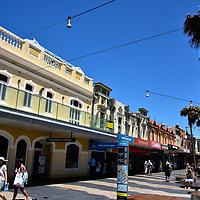 The Corso at Manly in Sydney, Australia<br /> Linking Manly Cove and the famous Manly Beach is The Corso. It was created as a boardwalk in 1855 and bookended with hotels for Sydney vacationers. This short pedestrian walkway is lined with Victorian facades housing restaurants, bars, cafes, surf stores plus three shopping arcades. During a 2007 redevelopment, large circular benches were added beneath the palm trees. These are an ideal place to grab a lunch. But beware: the seagulls might grab it first.