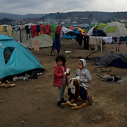 Syrian children play outside a tent at the Greek-Macedonian border station of Idomeni, Greece. Around 13,000 migrants and refugees, mostly from the Middle East and African nations, are believe to be stranded here awaiting a chance to proceed their journey towards Germany and other northern European countries.