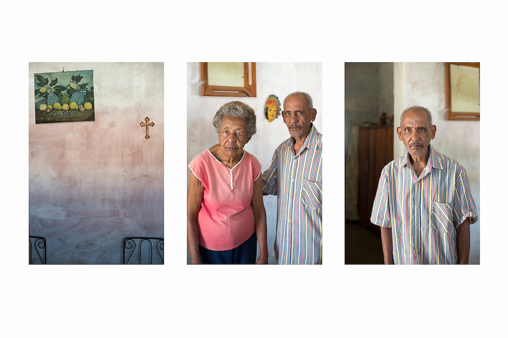 Triptych representing a couple stand in the doorway of their home.