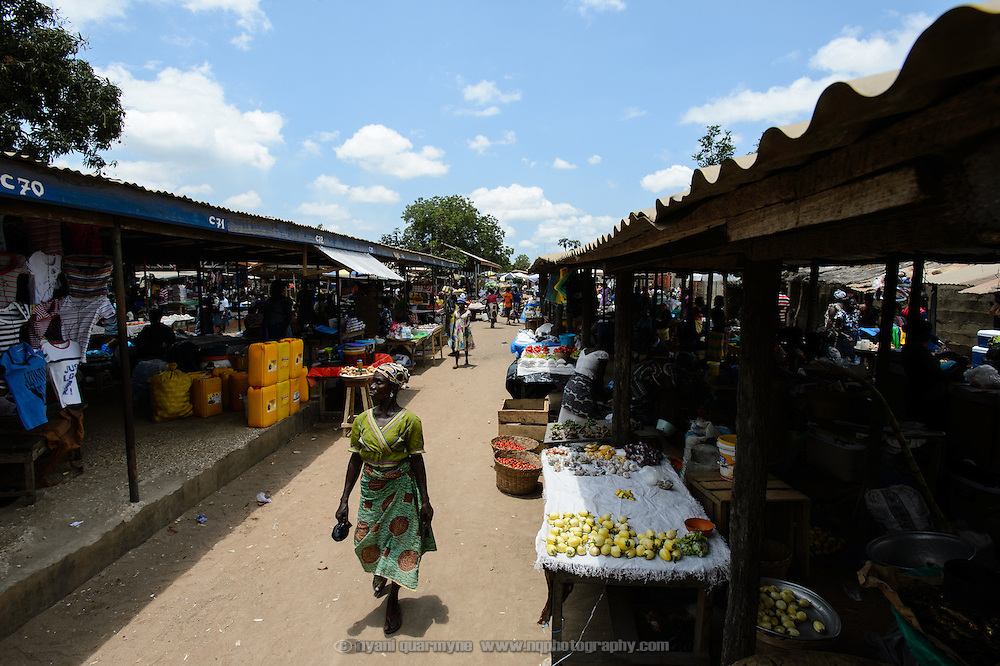 A woman makes her way through a market in Dabala Junction in the Volta Region of Ghana.