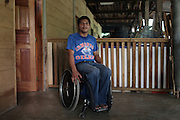 German Chub Choc, Q'eqchi' Mayan from El Estor, sits at home on his wheelchair. On September 27, 2009, German was shot during a botched eviction-turned-melee by Mynor Padilla, former head of security for the Guatemalan Nickel Company (CGN). After nearly losing his life, German recovered but now suffers from paraplegia. Numerous people were also injured or killed during the event, including former schoolteacher and local anti-mining leader Adolfo Ich Chaman. A criminal case against Padilla is underway in Guatemala for the shooting of Chub Choc and murder of Ich Chaman. Meanwhile, a landmark legal case against CGN parent company HudBay Minerals is underway in Canada. El Estor, Izabal, Guatemala. May 31, 2012.