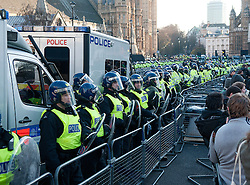 © under license to London News Pictures.  09/12/2010. Police assemble in Parliament Square in London. Students gethered for the fourth time in as many weeks to protest the proposed rise in tuition fees. Photo credit should read Michael Graae/London News Pictures