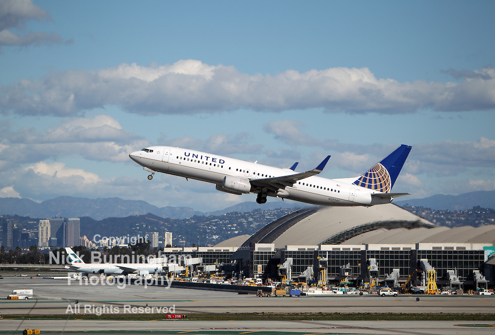 LOS ANGELES, CALIFORNIA, USA - JANUARY 28, 2013 - United Airlines Boeing 737-824 takes off from Los Angeles Airport on January 28, 2013. The plane seats 162 passengers with a range of 5,765 km.