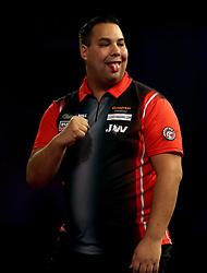Jermaine Wattimena reacting during day three of the William Hill World Darts Championship at Alexandra Palace, London.