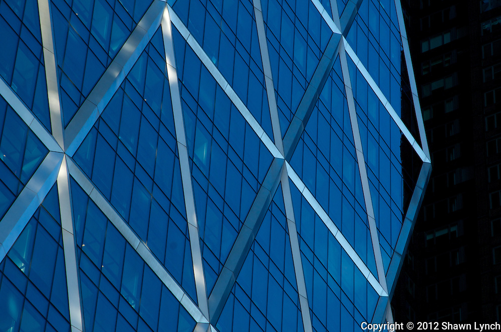 A detailed photograph of the Hearst Tower in New York City.  The building's triangular framing has been reported to have reduced the amount of steel needed for construction by approximately 20%.