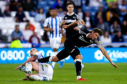 Kieran Dowell of Derby County is tackled by Aaron Mooy of Huddersfield Town - Mandatory by-line: Robbie Stephenson/JMP - 05/08/2019 - FOOTBALL - The John Smith's Stadium - Huddersfield, England - Huddersfield Town v Derby County - Sky Bet Championship