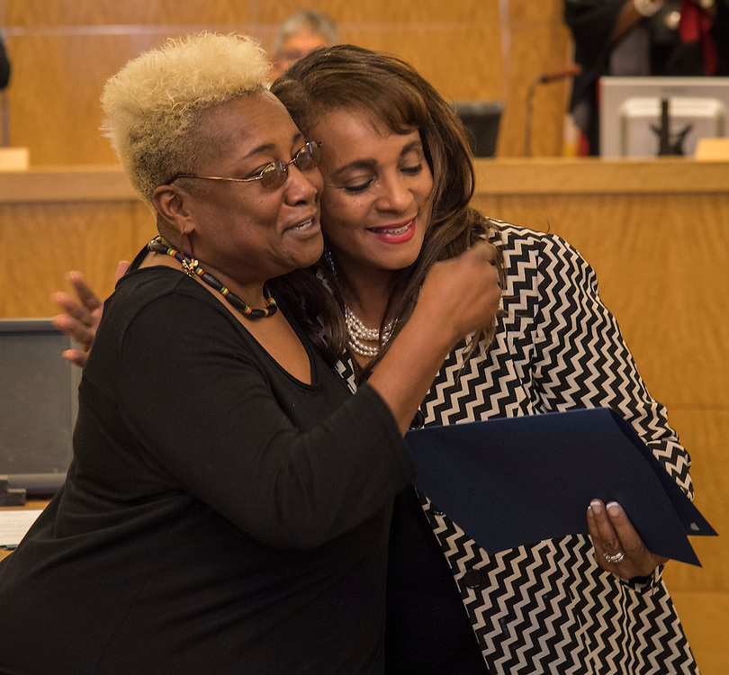 Wretha Thomas, left, is recognized by Rhonda Skillern-Jones, right, during the Houston ISD Board of Trustee meeting, November 10, 2016.