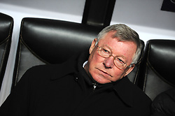 Sir Alex Ferguson of Manchester United watches from the bench during the UEFA Champions League First Knock-Out Round match between AC Milan and Manchester United at the San Siro Stadium on February 16 2010 in Milan, Italy.