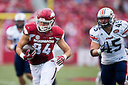 FAYETTEVILLE, AR - OCTOBER 31:  Hunter Henry #84 of the Arkansas Razorbacks is chased by Caleb Counce #45 of the UT Martin Skyhawks at Razorback Stadium on October 31, 2015 in Fayetteville, Arkansas.  The Razorbacks defeated the Skyhawks 63-28.  (Photo by Wesley Hitt/Getty Images) *** Local Caption *** Hunter Henry; Caleb Counce