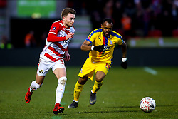 Alfie May of Doncaster Rovers goes past Jordan Ayew of Crystal Palace - Mandatory by-line: Robbie Stephenson/JMP - 17/02/2019 - FOOTBALL - The Keepmoat Stadium - Doncaster, England - Doncaster Rovers v Crystal Palace - Emirates FA Cup fifth round proper