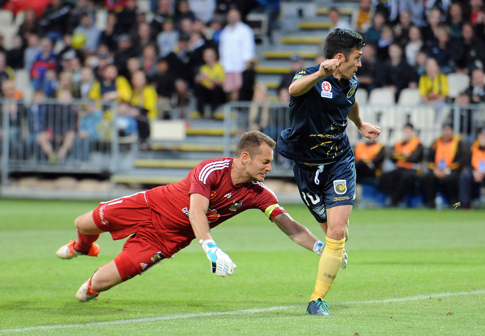 Central Coast Mariners' Luis Garcia back heels pass Phoenix's Glen Moss to score his teams first goal in the A-League football match at AMI Stadium, Christchurch, New Zealand, Saturday, January 30, 2016. Credit:SNPA / Ross Setford