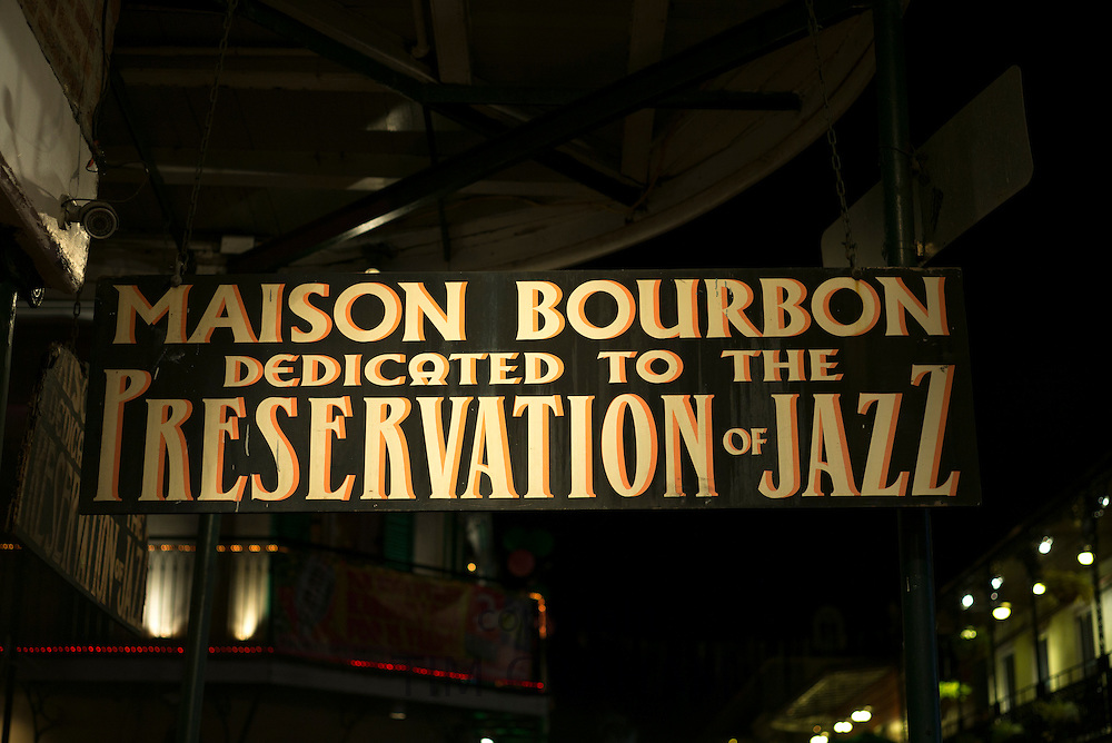 Maison Bourbon live jazz club sign in famous Bourbon Street in French Quarter of New Orleans, Louisiana, USA