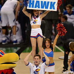 Mar 31, 2012; New Orleans, LA, USA; A Kansas Jayhawks cheerleader performs during the first half in the semifinals of the 2012 NCAA men's basketball Final Four against the Ohio State Buckeyes at the Mercedes-Benz Superdome. Mandatory Credit: Derick E. Hingle-US PRESSWIRE