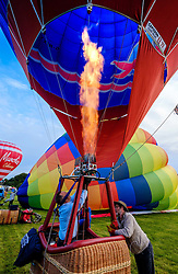 Strathaven Scotland UK 27th August 2016 - The Strathaven Balloon Festival is an annual event and the only one of its kind in Scotland held in 2016 from 26th - 28th August. The first flights of the festival took place at dawn on Saturday 27th August <br /> <br /> Firing the burners in preparation for a flight.<br /> <br /> (c) Andrew Wilson | Edinburgh Elite media