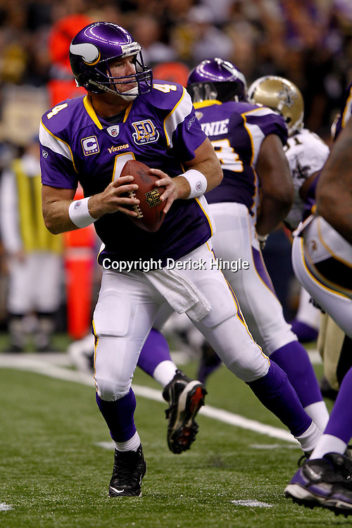 September 9, 2010; New Orleans, LA, USA;  Minnesota Vikings quarterback Brett Favre (4) drops back to pass during the NFL Kickoff season opener at the Louisiana Superdome. The New Orleans Saints defeated the Minnesota Vikings 14-9.  Mandatory Credit: Derick E. Hingle