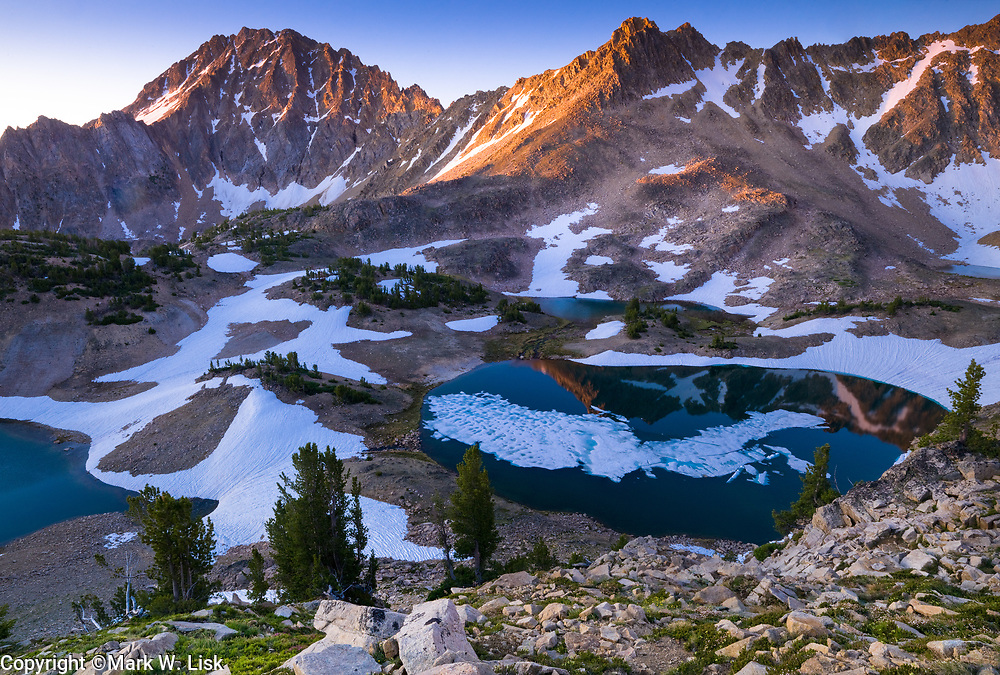 The high lakes of the Four Lakes basin hold ice and snow well into July, White Cloud Peaks, Idaho.