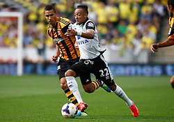 Norwich City's Nathan Redmond beats Hull City's Jake Livermore for pace  - Photo mandatory by-line: Matt Bunn/JMP - Tel: Mobile: 07966 386802 24/08/2013 - SPORT - FOOTBALL - KC Stadium - Hull -  Hull City V Norwich City - Barclays Premier League