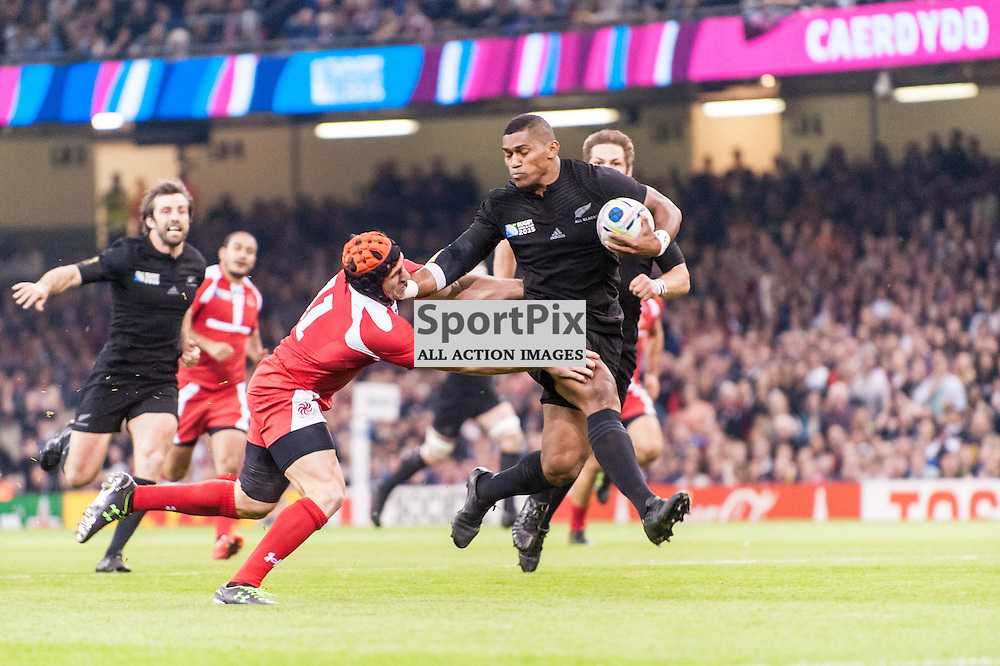 All Black Waisake Naholo bursts through to score the first try, just 3 months after breaking his leg. Action from the New Zealand v Georgia game in Pool C of the 2015 Rugby World Cup at Milennium Stadium in Cardiff, 2 October 2015. (c) Paul J Roberts / Sportpix.org.uk