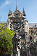 A statue of Saint John Paul next to Notre-Dame Cathedral on the Il de la Cite. Paris, France, Europe