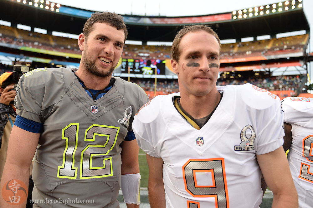 January 26, 2014; Honolulu, HI, USA; Team Sanders quarterback Andrew Luck of the Indianapolis Colts (12) talks to Team Rice quarterback Drew Brees of the New Orleans Saints (9) during the third quarter of the 2014 Pro Bowl at Aloha Stadium. Team Rice defeated Team Sanders 22-21.