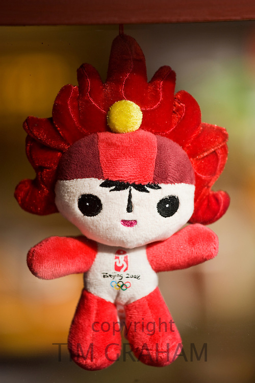 2008 Olympic Games official souvenirs Fuwa mascot Olympic flame character Huan Huan in Beijing shop, China