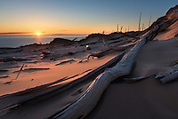 The sun sets over Lake Michigan and the Ghost Forest at Sleeping Bear Dunes National Lakeshore