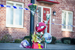© Licensed to London News Pictures. 03/02/2016. Allerton Bywater UK. Flowers are left at a scene on Beeston way were a police investigation is still underway after the bodies of two children & a woman were found at the property. Photo credit: Andrew McCaren/LNP