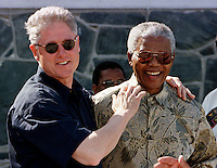 CAP11:AFRICA-CLINTON:CAPE TOWN,27MAR98 - U.S. President Bill Clinton (R) and South African President Nelson Mandela joke with reporters while on a tour of Robben Island March 27. Mandela spent the afternoon showing Clinton the penal colony where he was held for 17 years by the former South African government.  wm/Photo by Rick Wilking   REUTERS